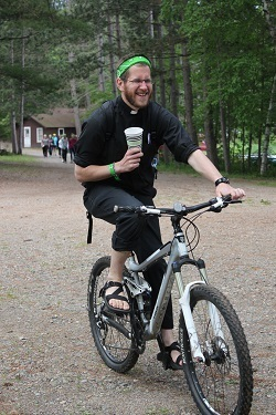Father Adam on a bike!